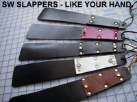 Daily Slapper in a variety of Handle and Jewel colors. They are generally made with one layer of black leather in the center, and are not sewn.