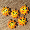 Whimsical happy brightly painted suns , clay beads from Guatemala
