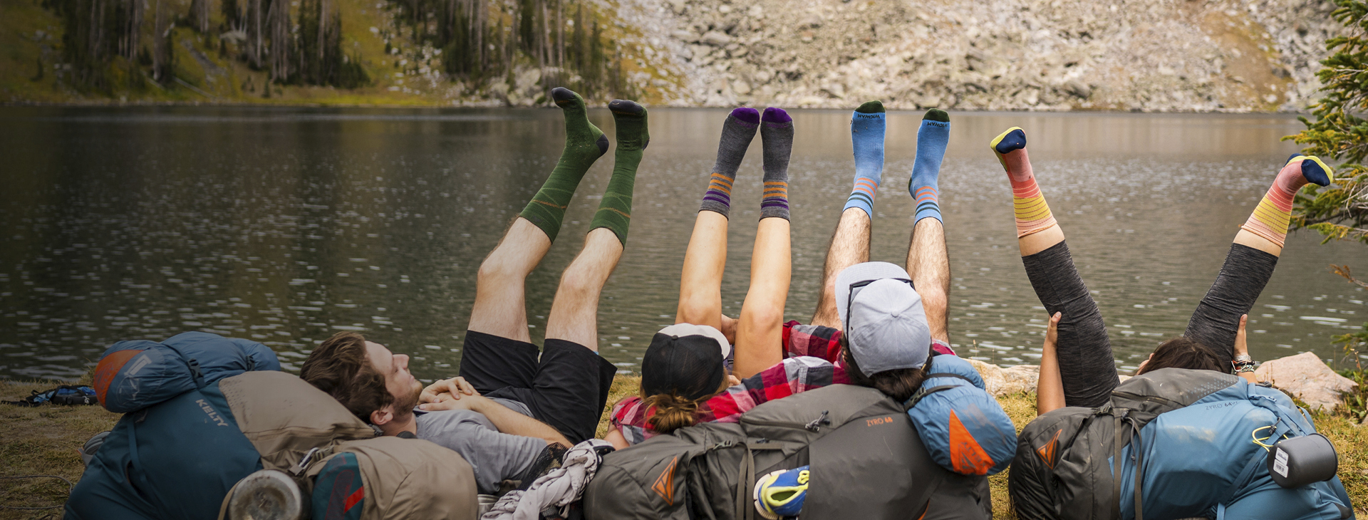 Group of campers lying down with their feet up in the air