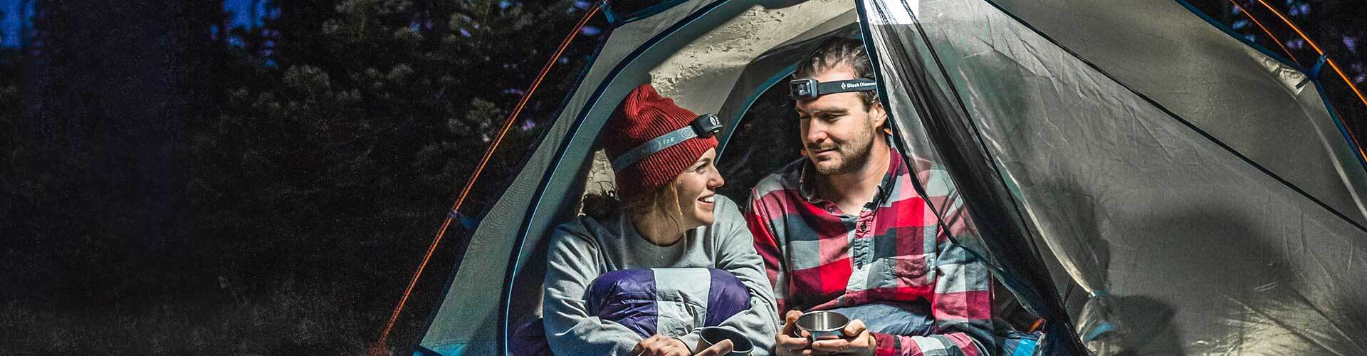Man and woman enjoying the cold weather in a Kelty tent