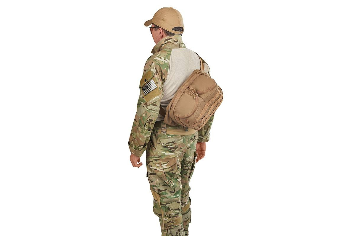 Soldier wearing the lid from Kelty Eagle Backpack, Coyote Brown on his back, sling-style