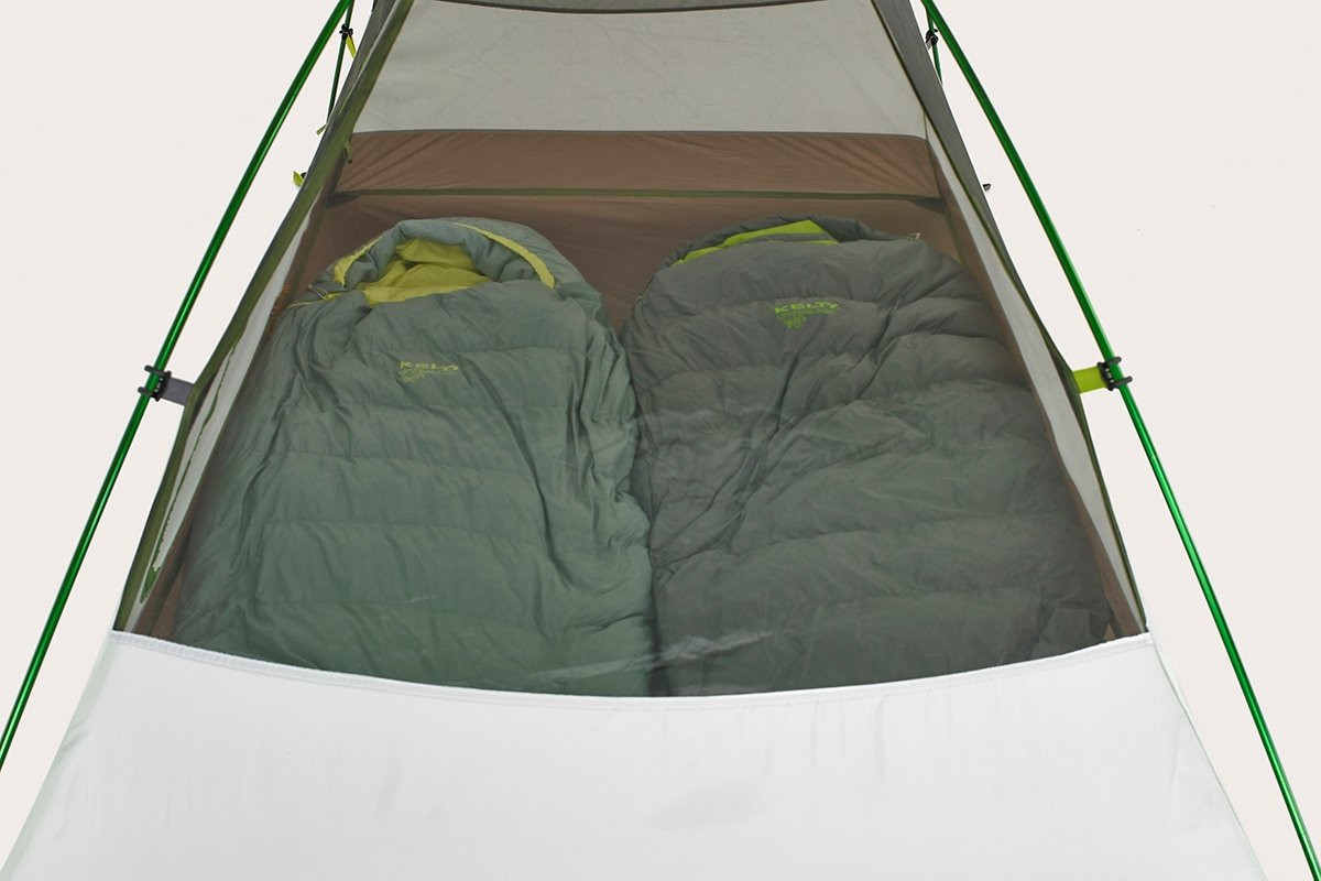 Close up of Kelty Salida 2 person tent, showing 2 sleeping bags placed side-by-side inside the tent