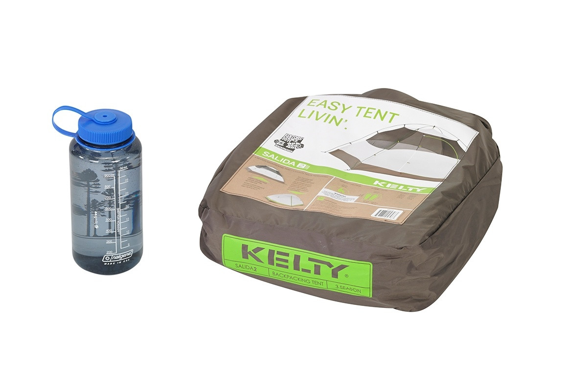 Kelty Salida 2 person tent, shown packed inside tan square-shaped storage bag, next to 32 oz. water bottle