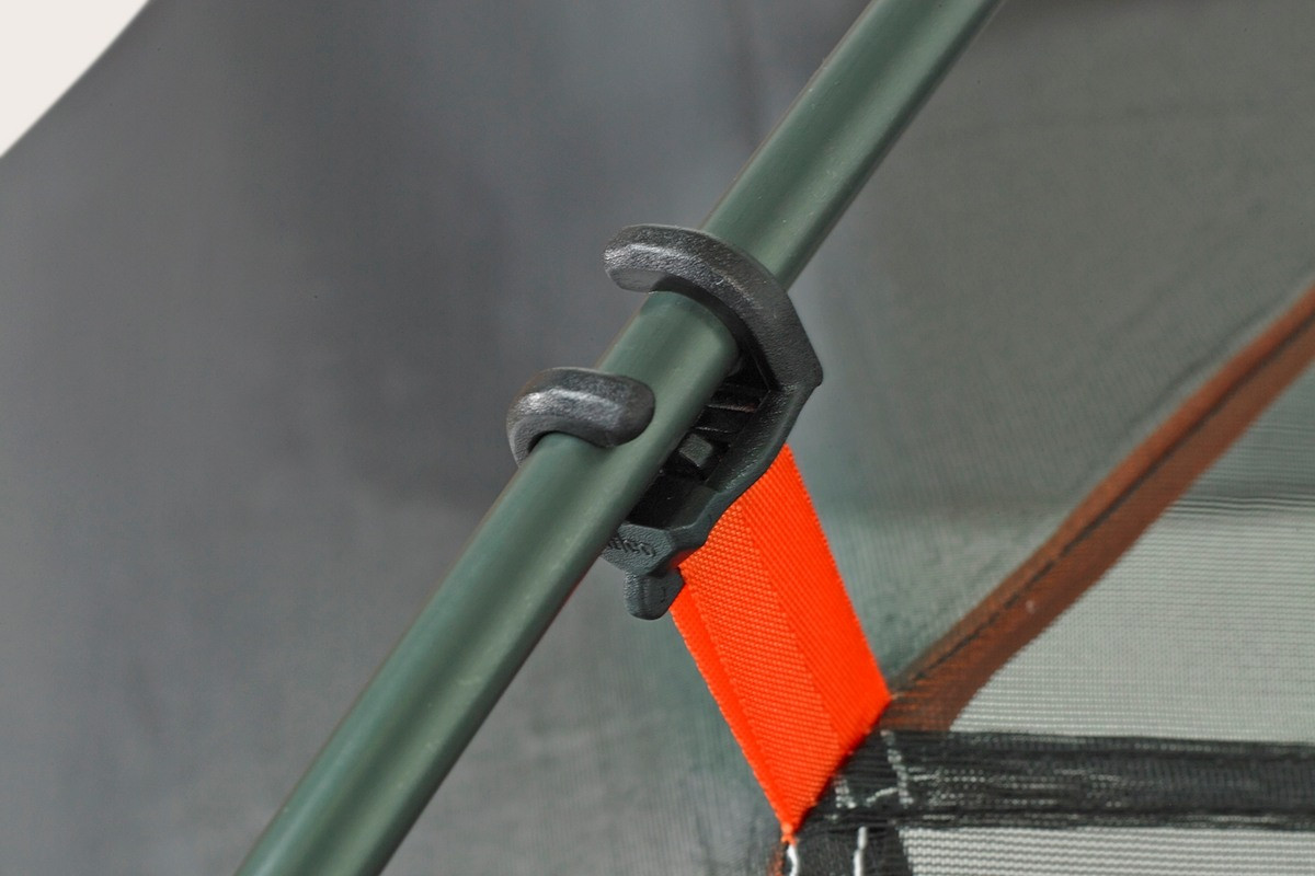 Close up of the Kelty Outfitter Pro 4 person tent, showing tent pole secured to tent body with a plastic clip