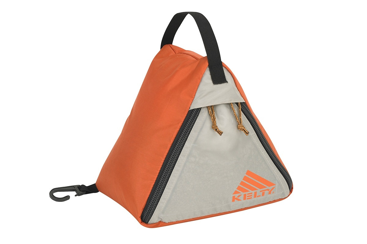 Kelty Sand Bag Stake, orange/tan, showing how product is a triangle-shaped nylon bag that can be filled with sand, rocks or other heavy objects