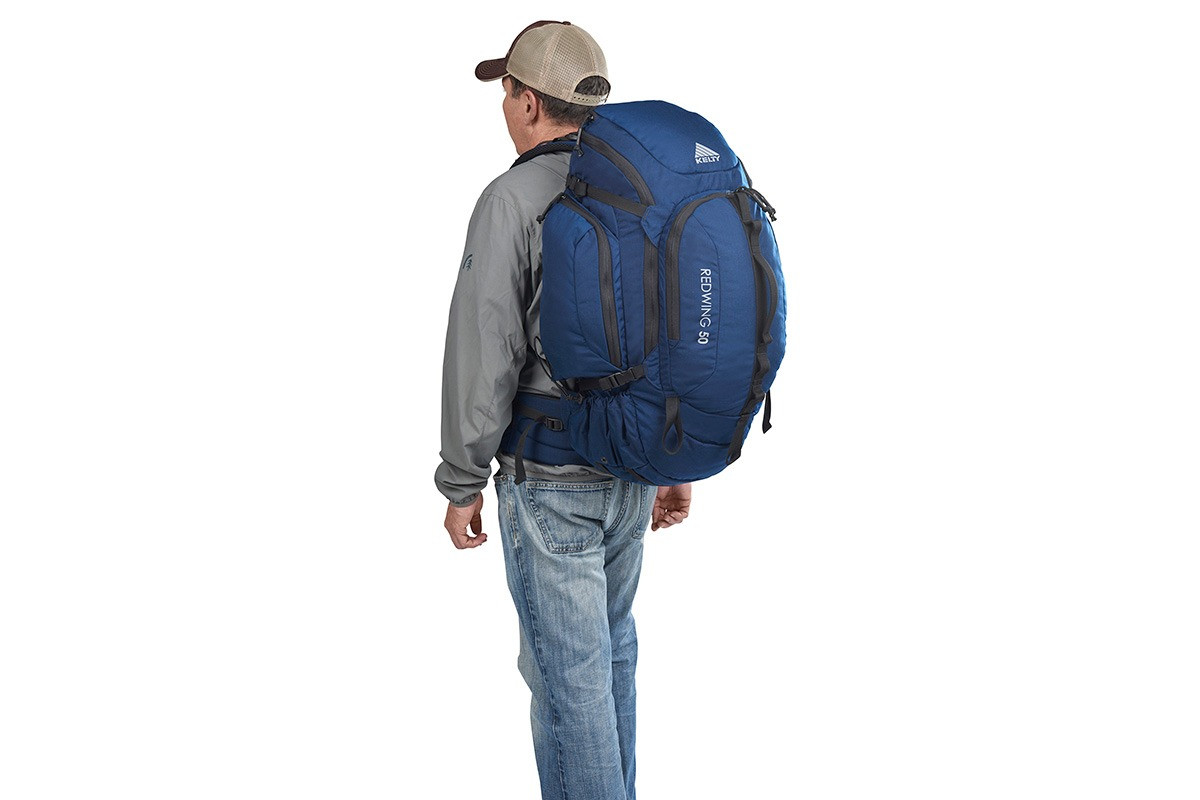 Man wearing Kelty Redwing 50 USA backpack, as seen from behind