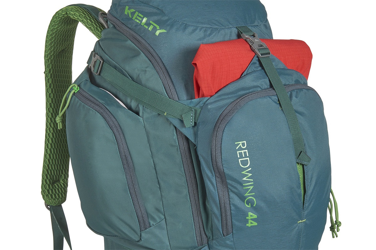 Close up of Kelty Redwing 44 backpack, showing red jacket packed in front pocket