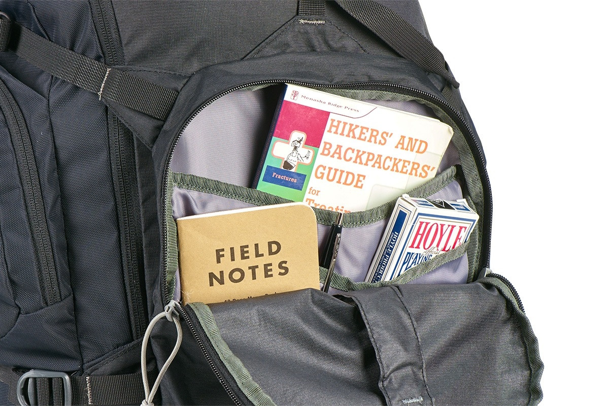 Close up of Kelty Women's Redwing 40 backpack, with front compartment unzipped, showing multiple interior storage pockets