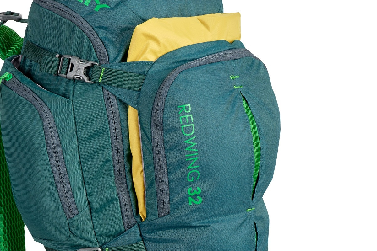 Close up of Kelty Redwing 32 backpack, showing yellow jacket packed in front pocket