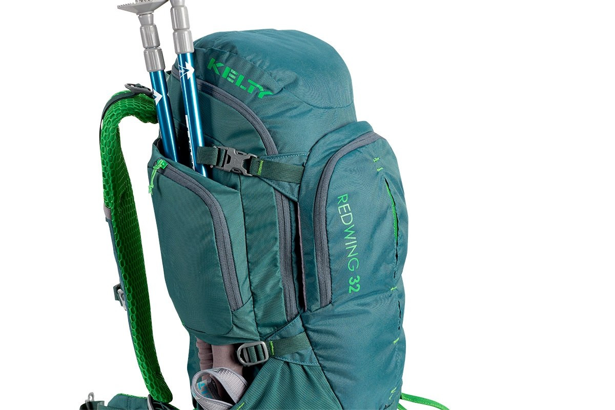 Close up of Kelty Redwing 32 backpack, showing trekking poles packed behind the side storage pocket