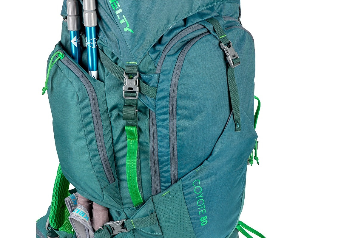 Kelty Coyote 80 backpack, Ponderosa Pine, shown with trekking poles attached to sides of pack