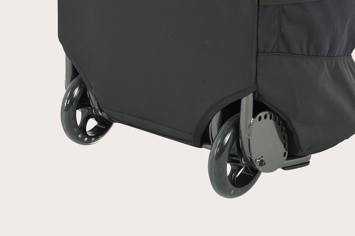 Kelty BRT USA rolling trunk,  black colorway, closeup of wheels
