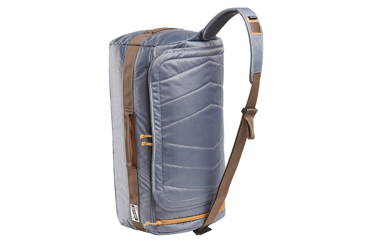 Kelty Dodger Duffel bag, Castle Rock, standing on its end, showing shoulder strap with pad