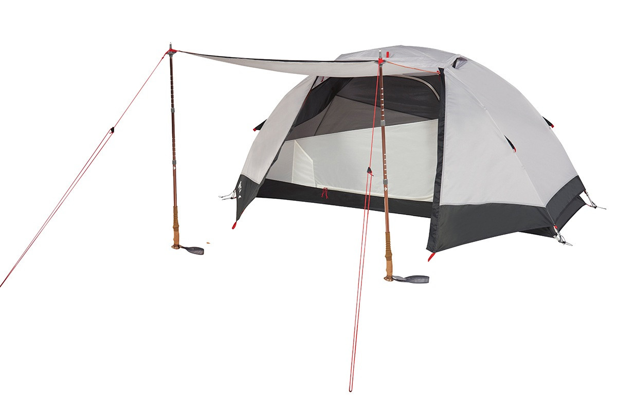 Kelty Gunnison 1 Tent, white, with rain fly attached and opened, flap propped up with trekking poles to create an awning in front of tent