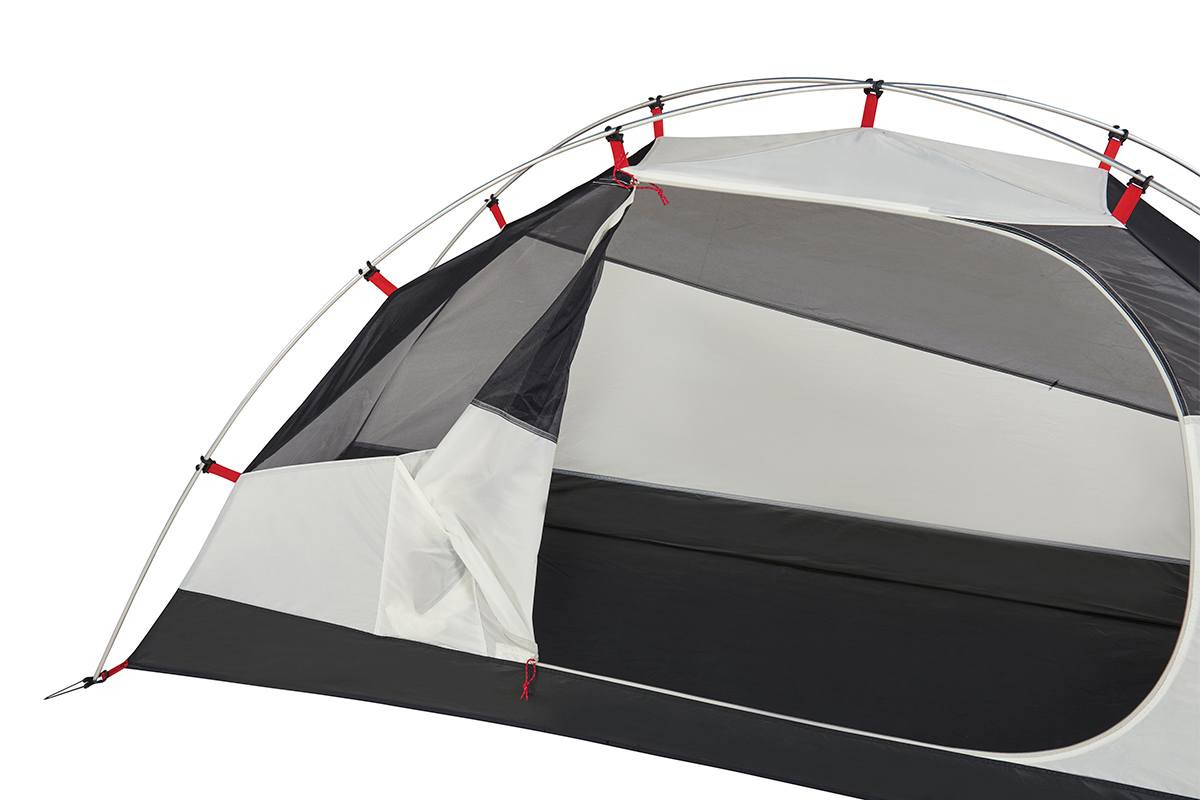 Close up of Kelty Gunnison 1 Tent, showing how unzipped door can be folded and stored in pocket located on the body of tent
