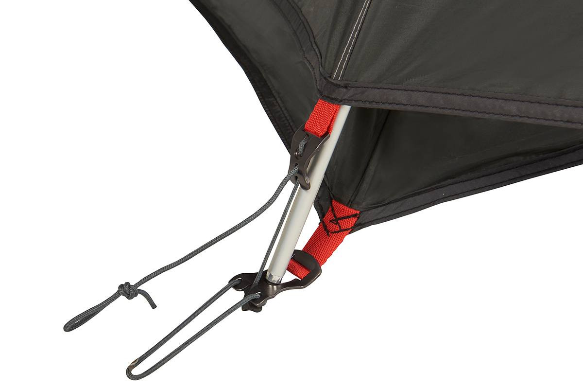 Close up of Kelty Gunnison 4 Tent, showing how rain fly attaches to the end of tent pole with nylon cord