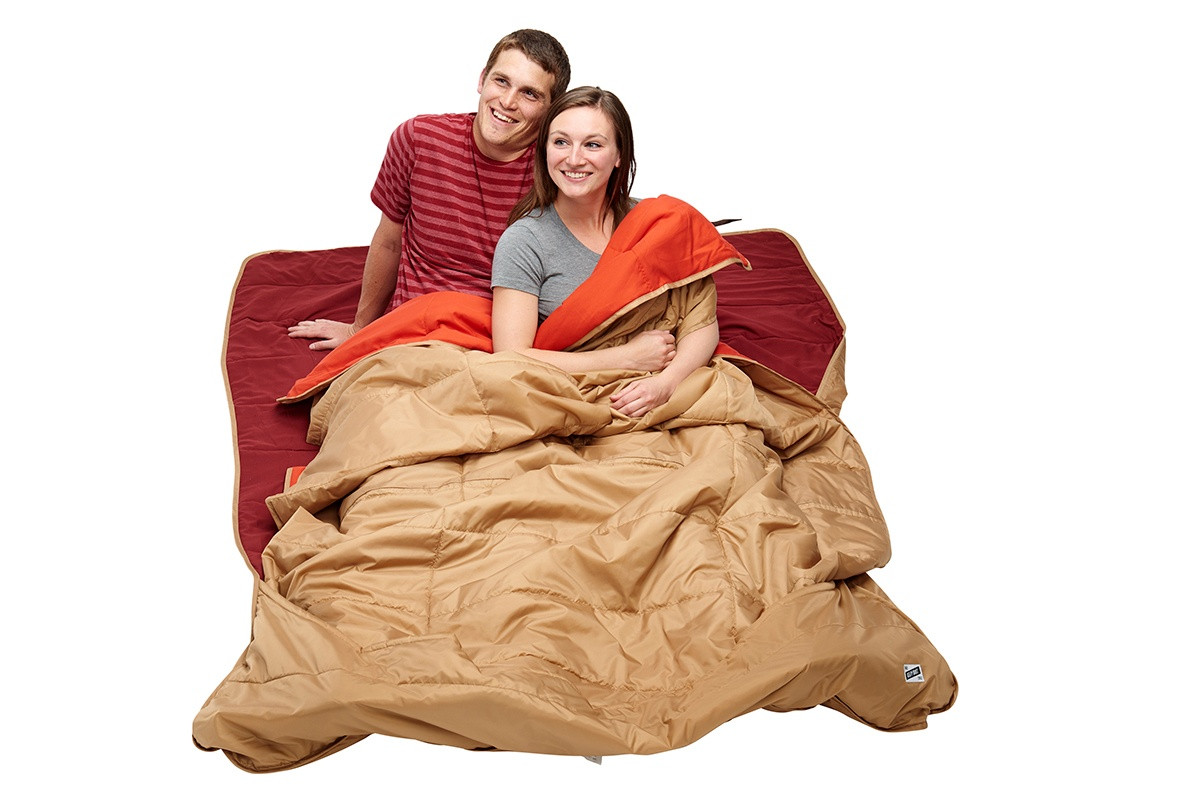 Man and woman sitting on Kelty Shindig Blanket