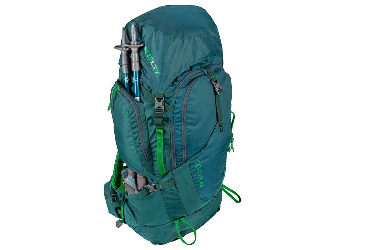 Kelty Coyote 65 backpack, Ponderosa Pine, shown with trekking poles attached to sides of pack