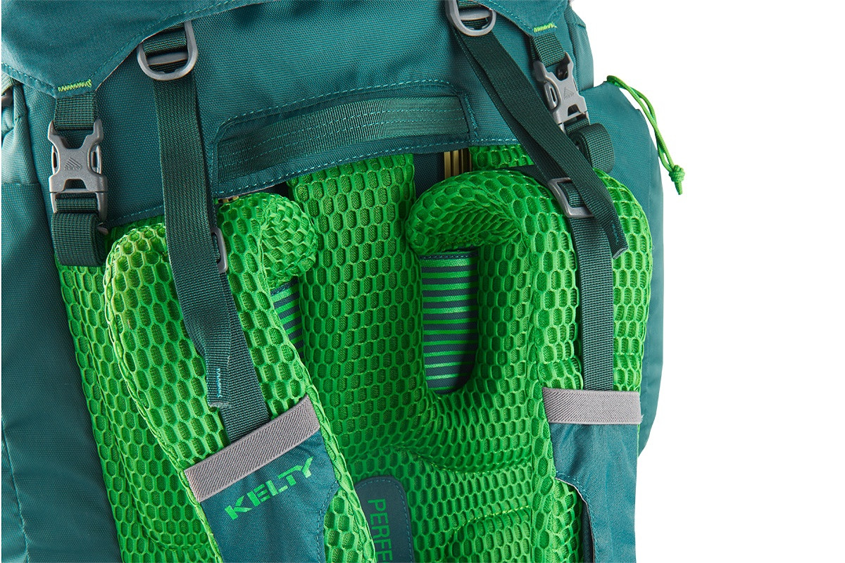 Close up of Kelty Coyote 65 backpack, Ponderosa Pine, showing bright green mesh shoulder straps