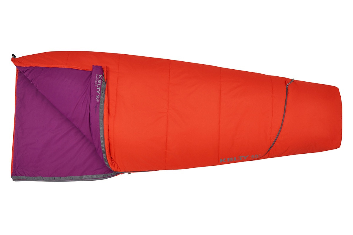 Kelty Rambler 50 sleeping bag, Fire Orange, unzipped quarter length to show purple interior fabric