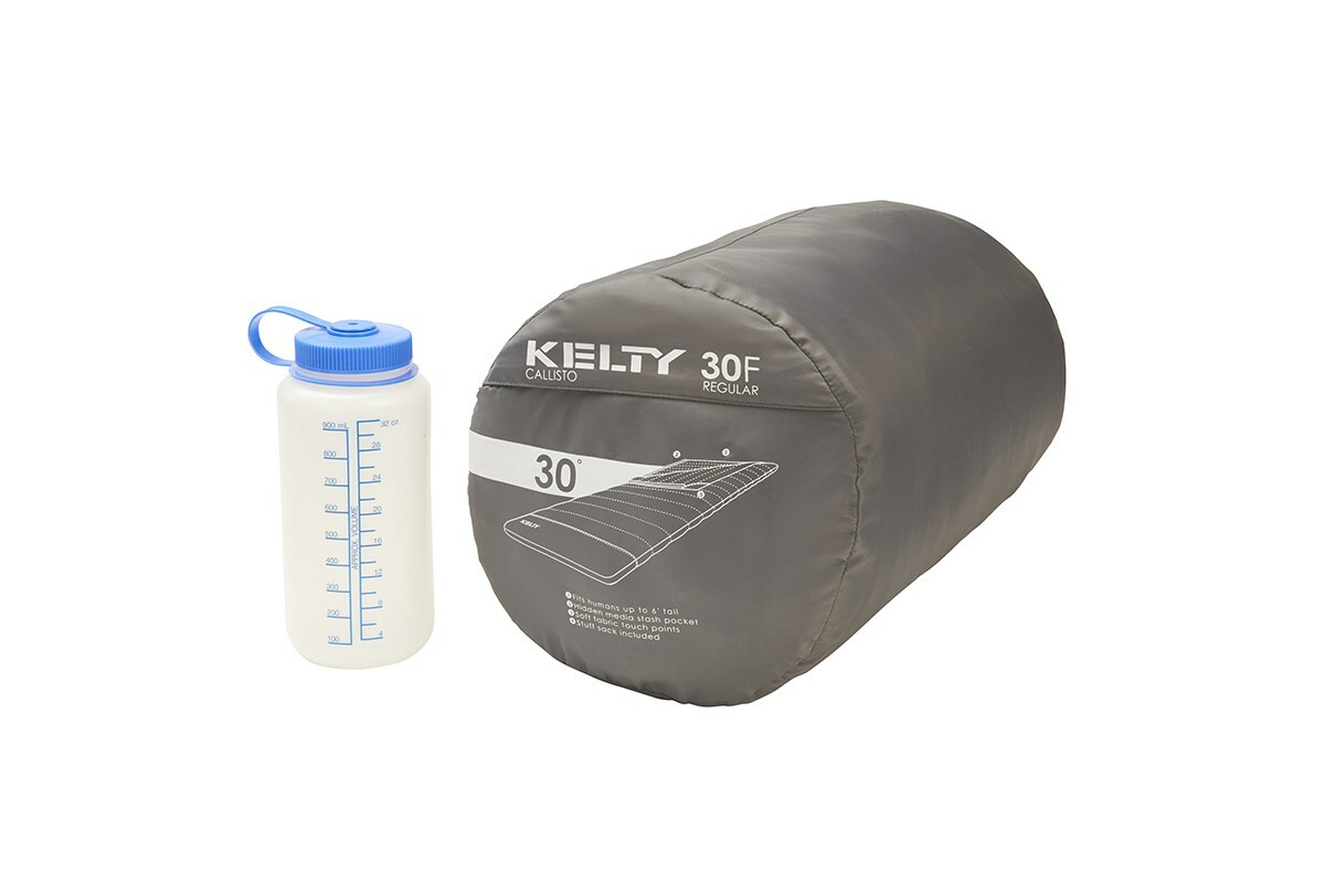 Kelty Callisto 30 sleeping bag, green, inside gray cylinder-shaped storage bag, next to 32 oz. water bottle
