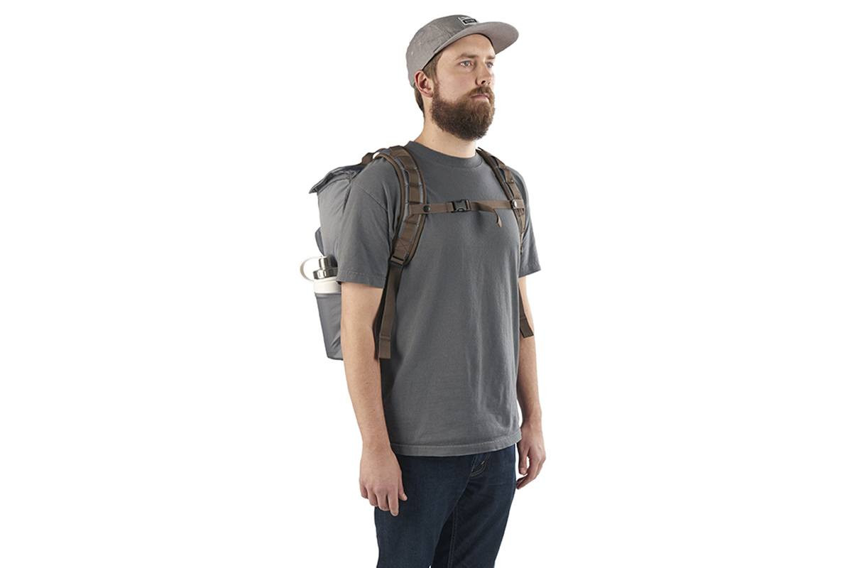 Man with beard, wearing a gray t-shirt and the Kelty Ardent backpack, front view