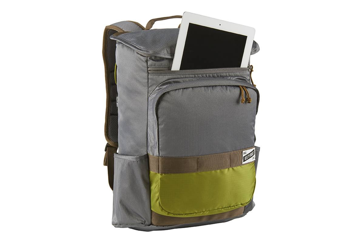 Kelty Ardent backpack, Castle Rock colorway, 3/4 view, with front pocket opened, showing how the pack can hold a tablet