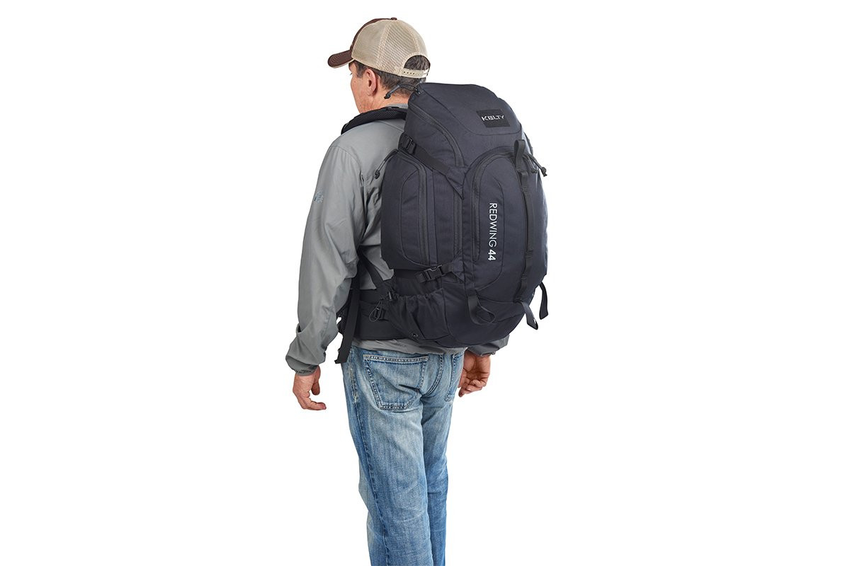 Man wearing Kelty Redwing 44 Tactical backpack, as seen from behind