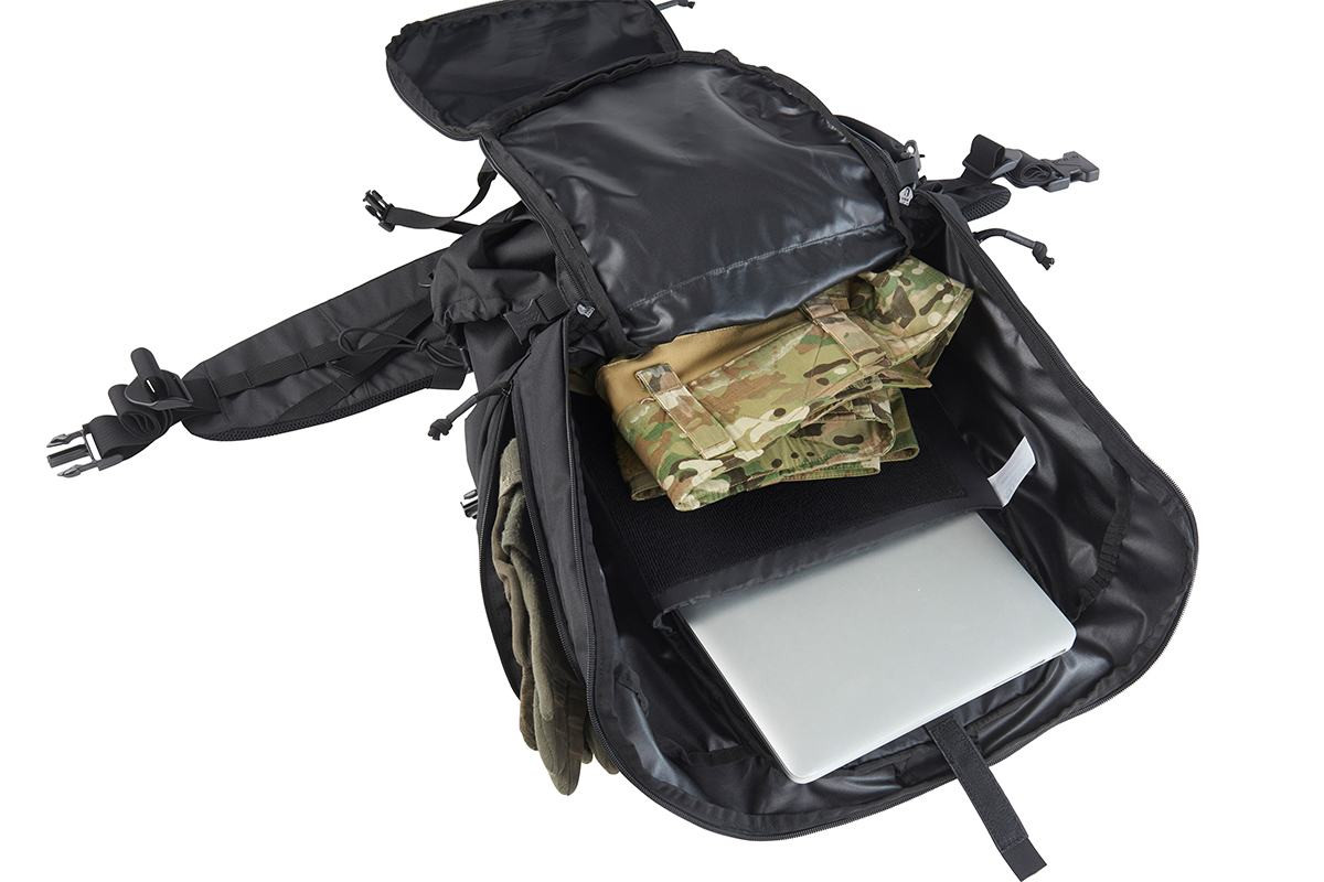 Close up of Kelty Redwing 50 Tactical backpack, opened to show large main storage compartment and padded laptop sleeve