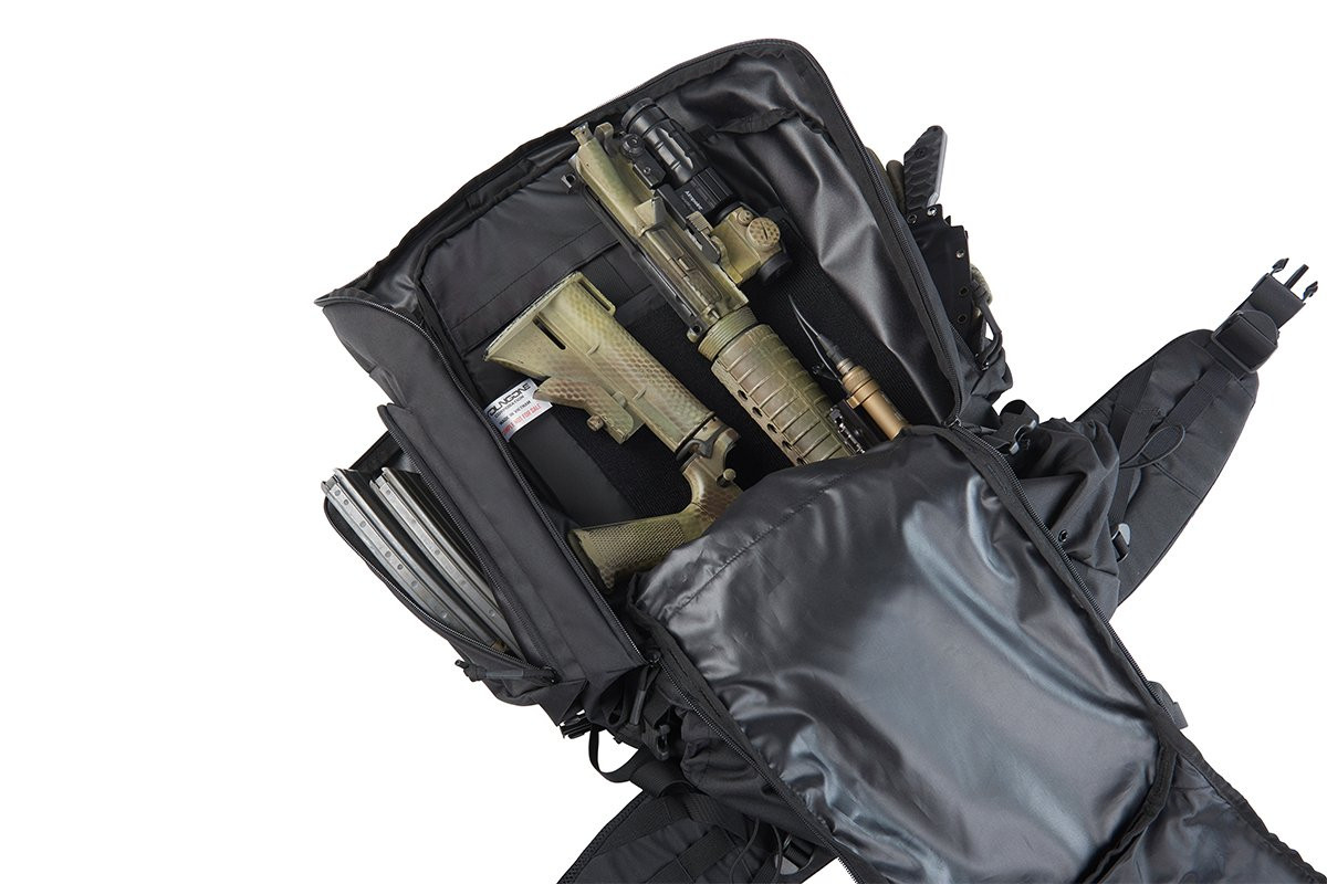 Close up of Kelty Redwing 50 Tactical backpack, opened to show partially disassembled AR-15 in large main storage compartment
