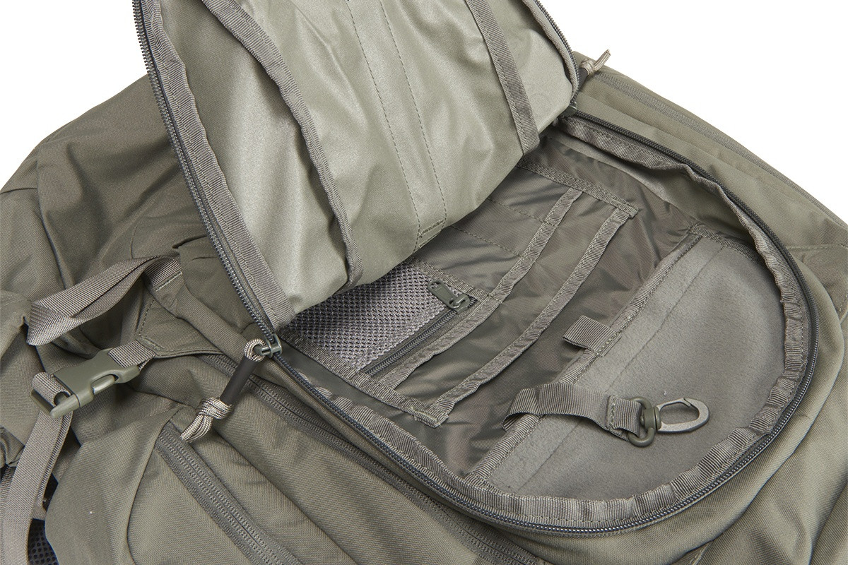 Close up of Kelty Redwing 50 Tactical backpack, with front pocket unzipped showing multiple small storage pockets inside