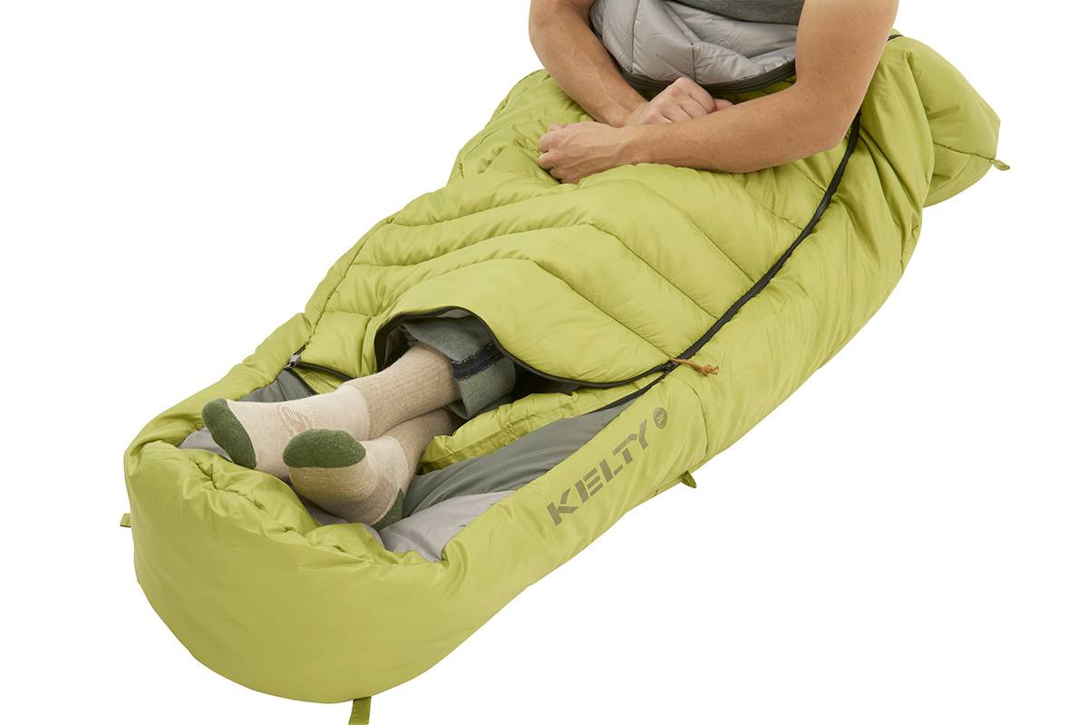 Kelty Tuck 20 Degree Sleeping Bag, shown with bottom unzipped to allow for venting of feet