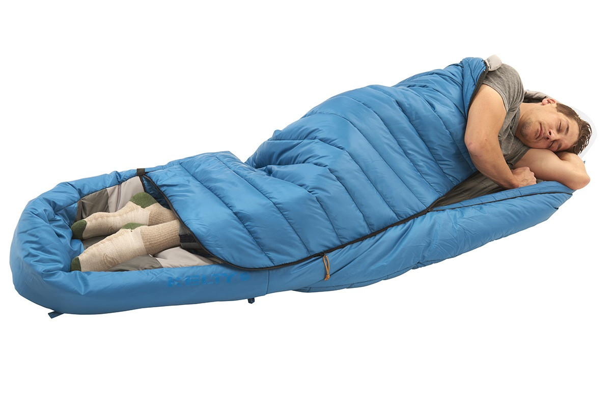 Man in Kelty Tuck 40 Degree Sleeping Bag, sleeping on his side