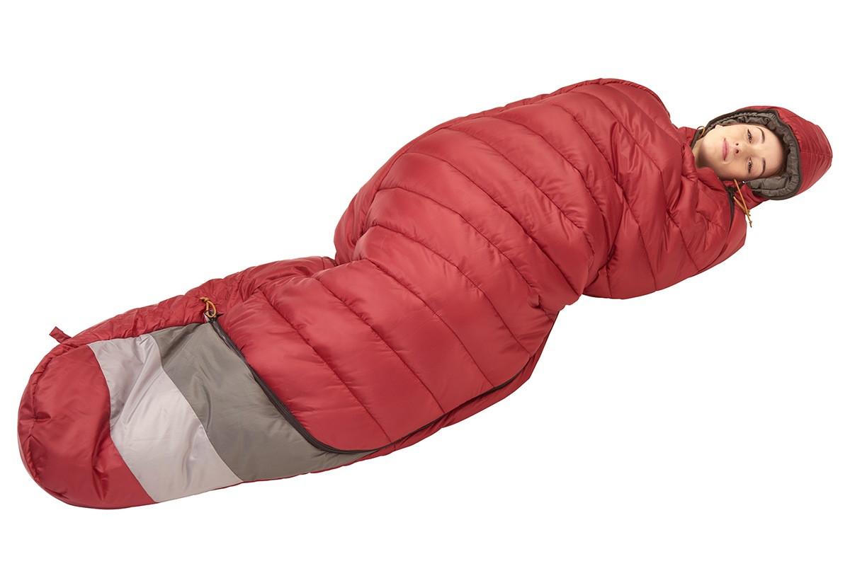 Woman in Kelty Women's Tuck 20 Degree Sleeping Bag, sleeping on her side