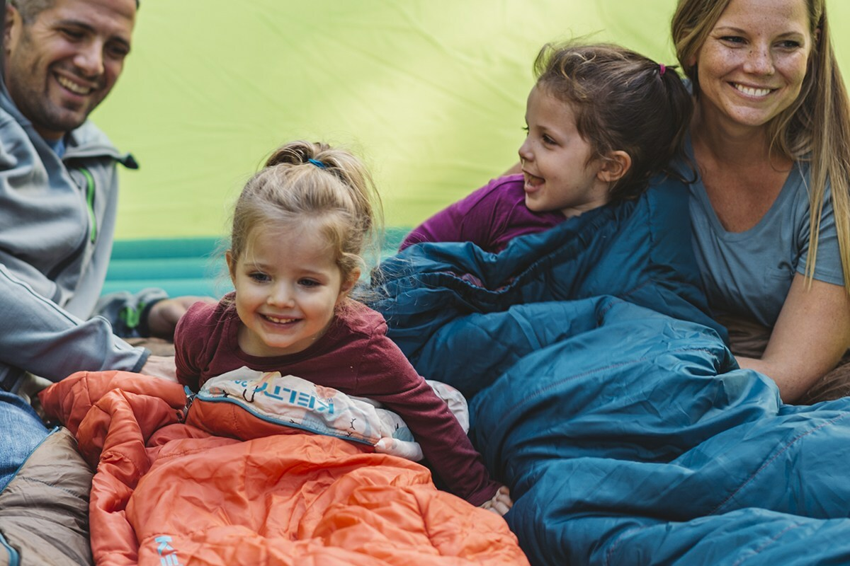 Family with children in sleeping bags