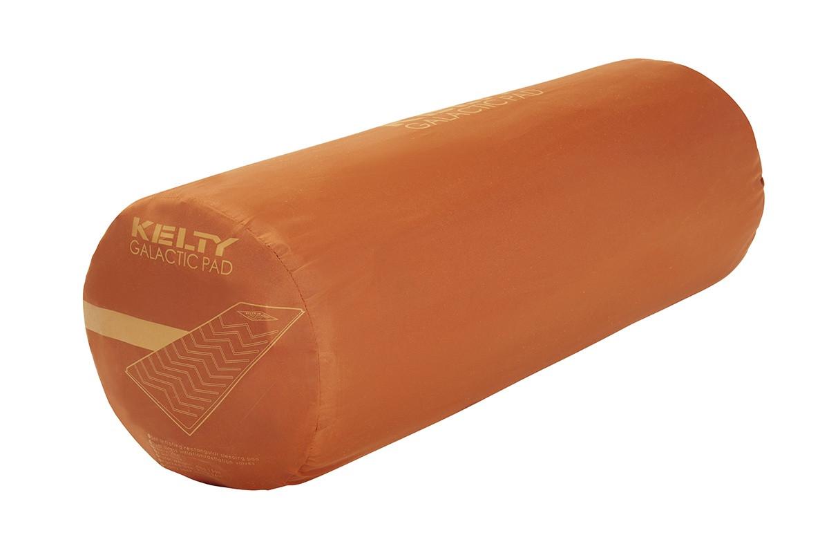 Kelty Galactic Sleeping Pad, packed inside orange cylinder-shaped storage bag