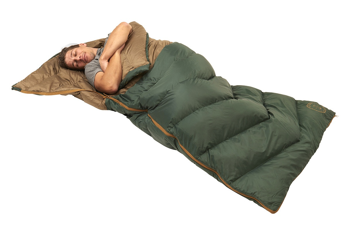 Man sleeping in Kelty Galactic 30 Dridown sleeping bag, on his back, with bag zipped