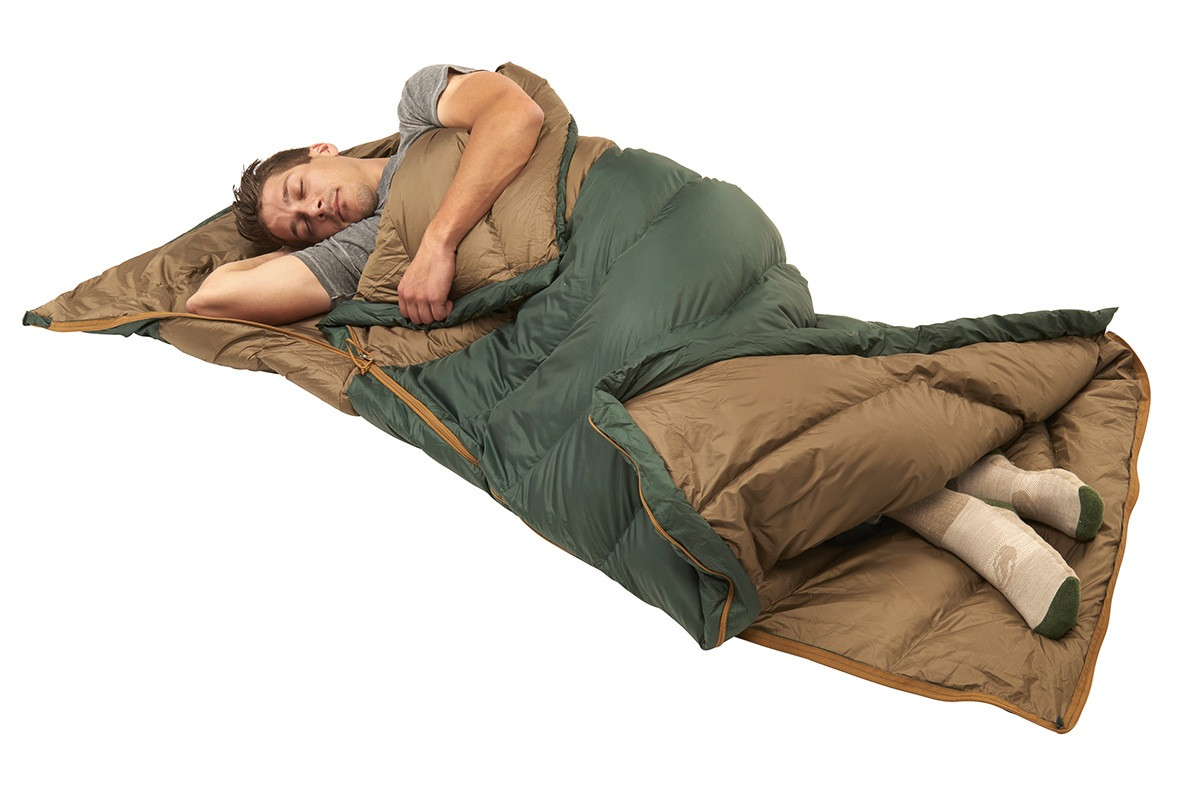 Man sleeping in Kelty Galactic 30 Dridown sleeping bag, on his back, with bag unzipped at bottom for ventilation