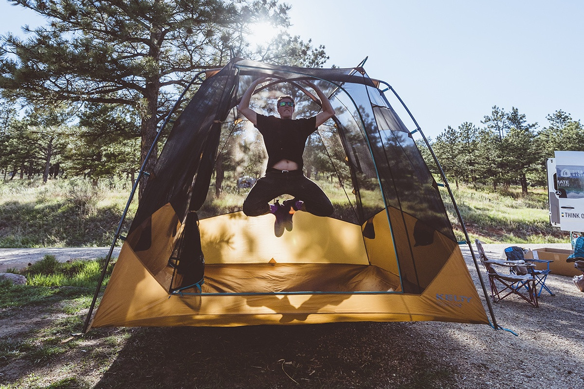 Man jumping inside of his Kelty Sequoia 4 person tent