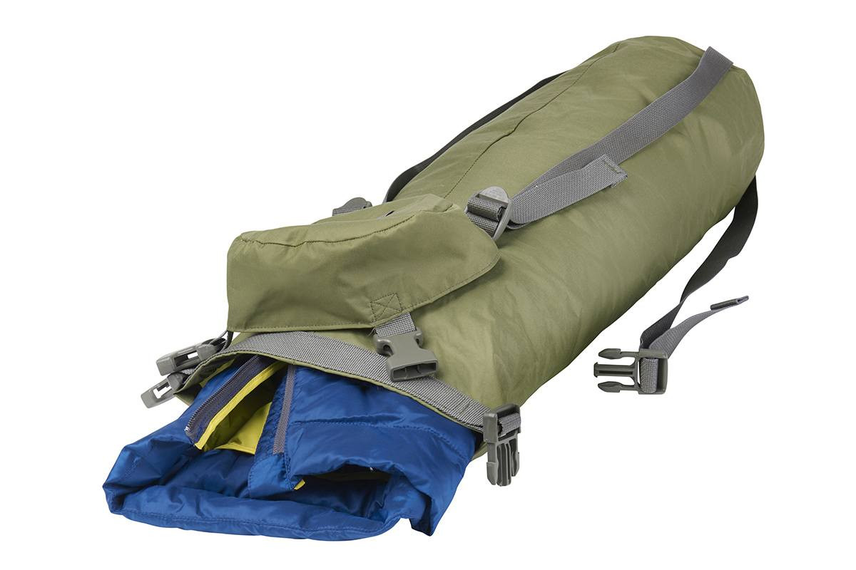 Kelty Varicom Compression Sack on its side, with roll top unbuckled and insulated jacket partially extended out of bag