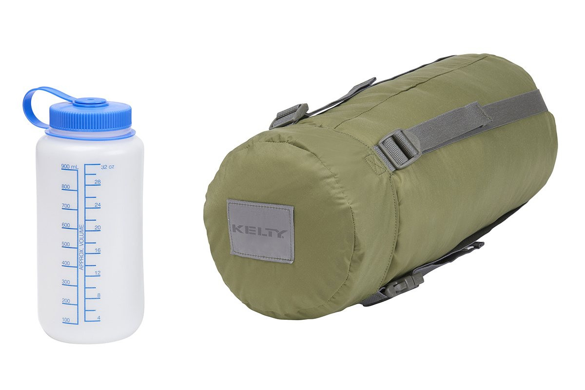 Kelty Varicom Compression Sack. shown next to 32 oz. water bottle