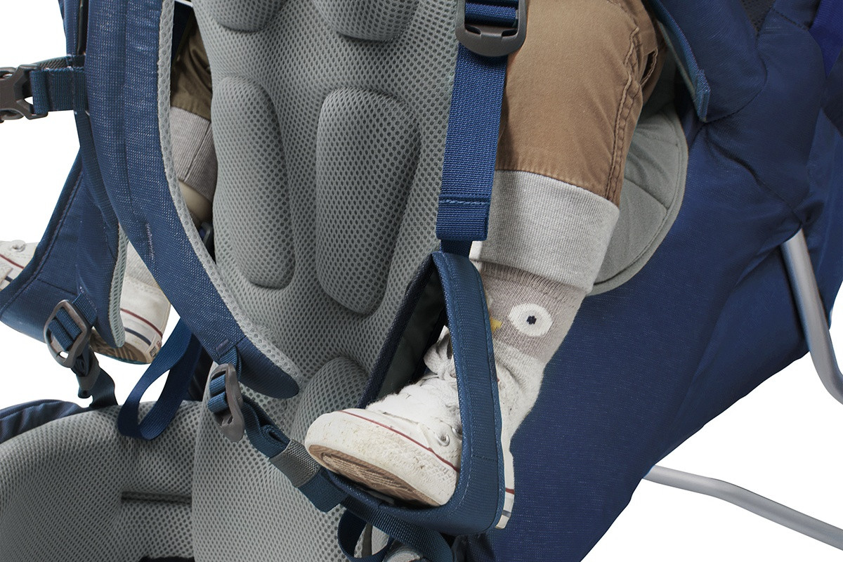 Close up of Kelty Journey PerfectFIT child carrier backpack, showing  adjustable foot stirrups for child