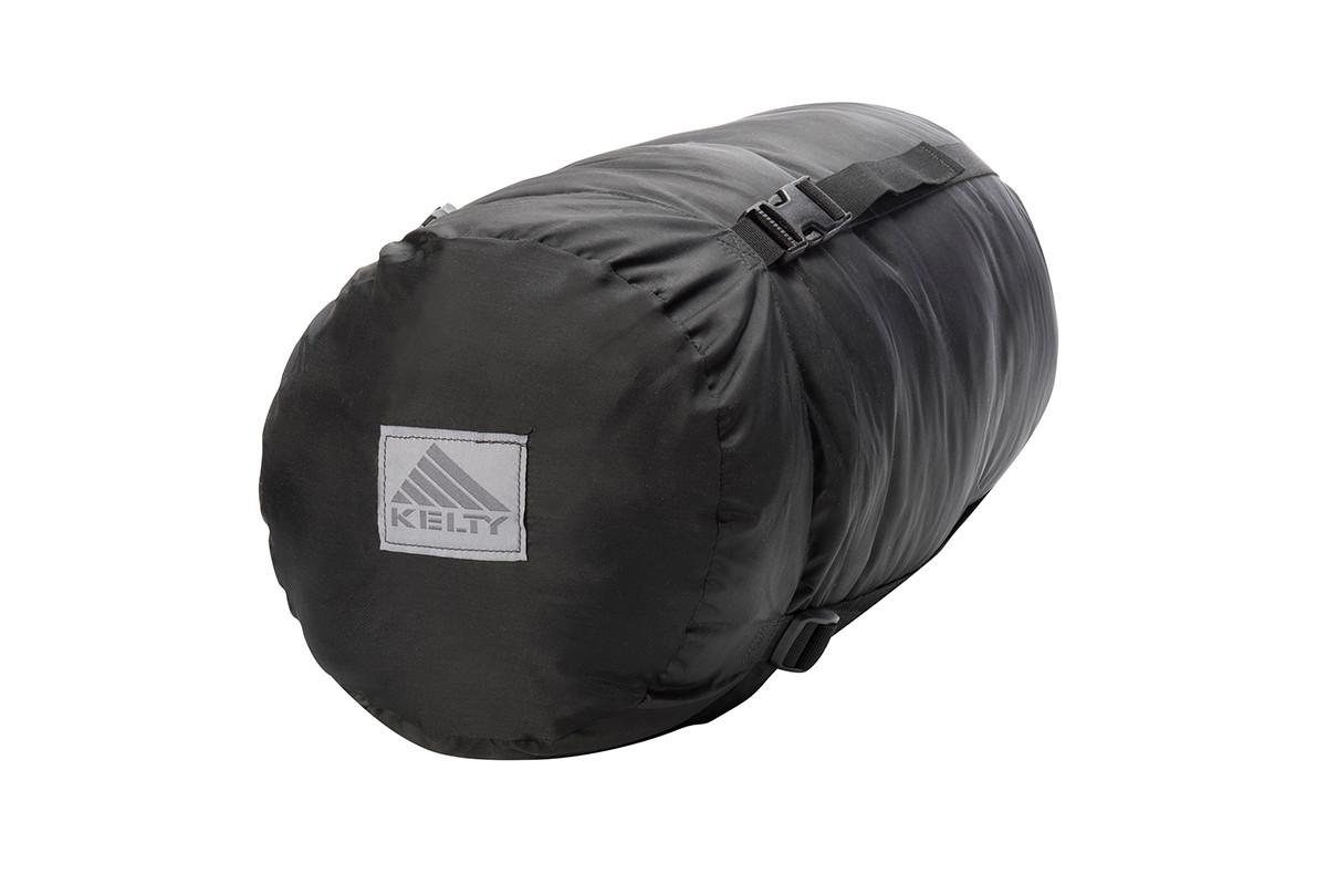 Kelty Tactical 0 Degree Field Bag, shown packed inside black cylinder-shaped storage bag