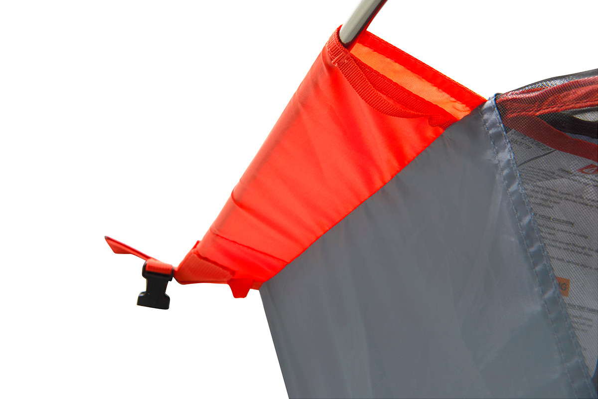 Close up of Kelty Late Start 1 person tent, showing orange pole sleeve from above