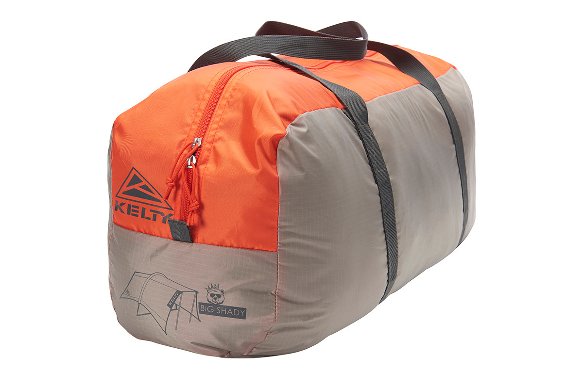 Kelty Big Shady tarp, tan colorway, packed inside tan and orange rectangular storage sack