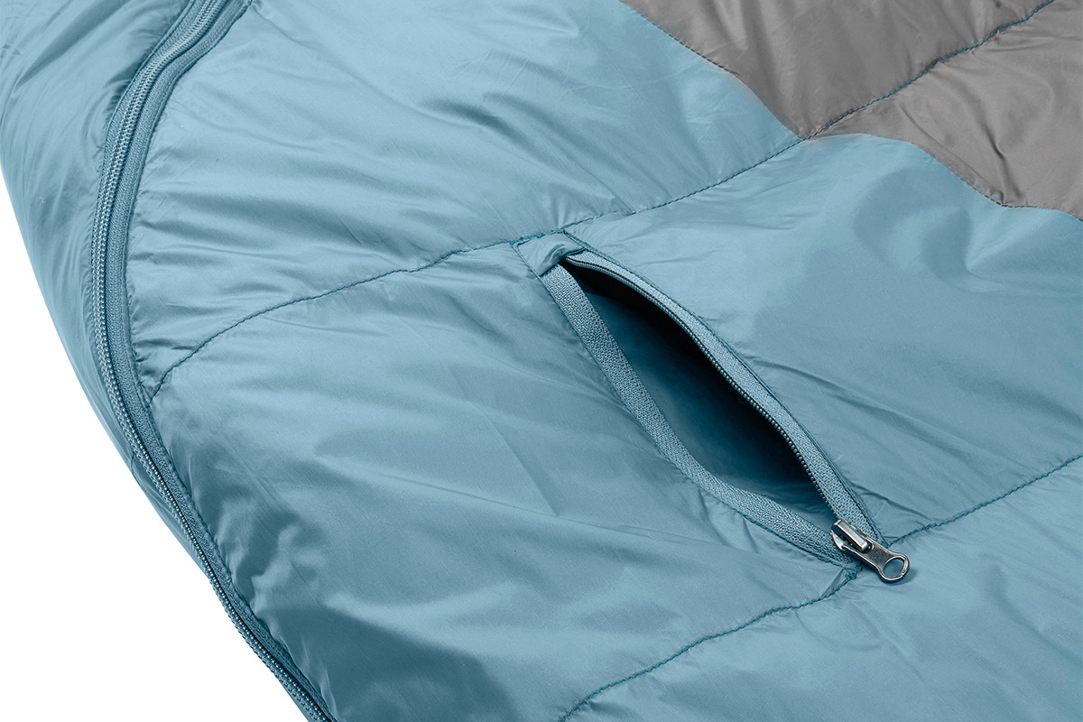 Close up of Kelty Cosmic 20 sleeping bag, showing small exterior zipper pocket