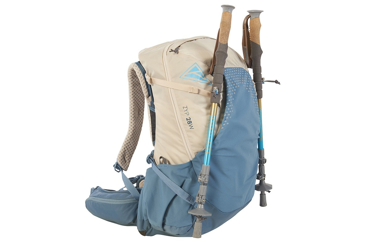 Kelty Women's Zyp 28 backpack, sand, with trekking poles attached to sides of pack