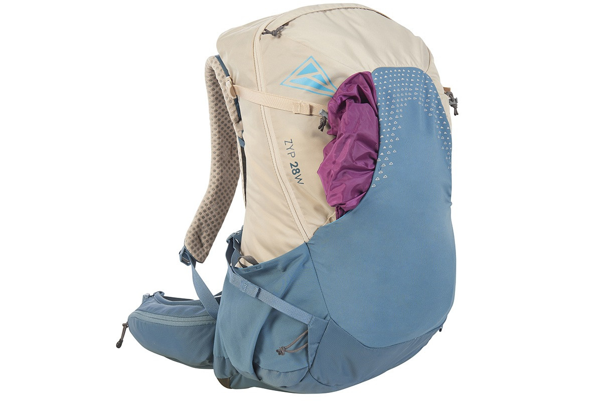 Kelty Women's Zyp 28, sand, with purple jacket stored in front pocket