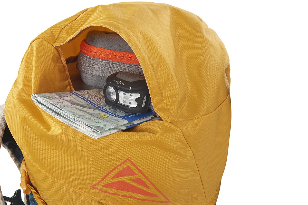 Close up of Kelty Zyp 38 backpack, showing headlamp and map stored in lid