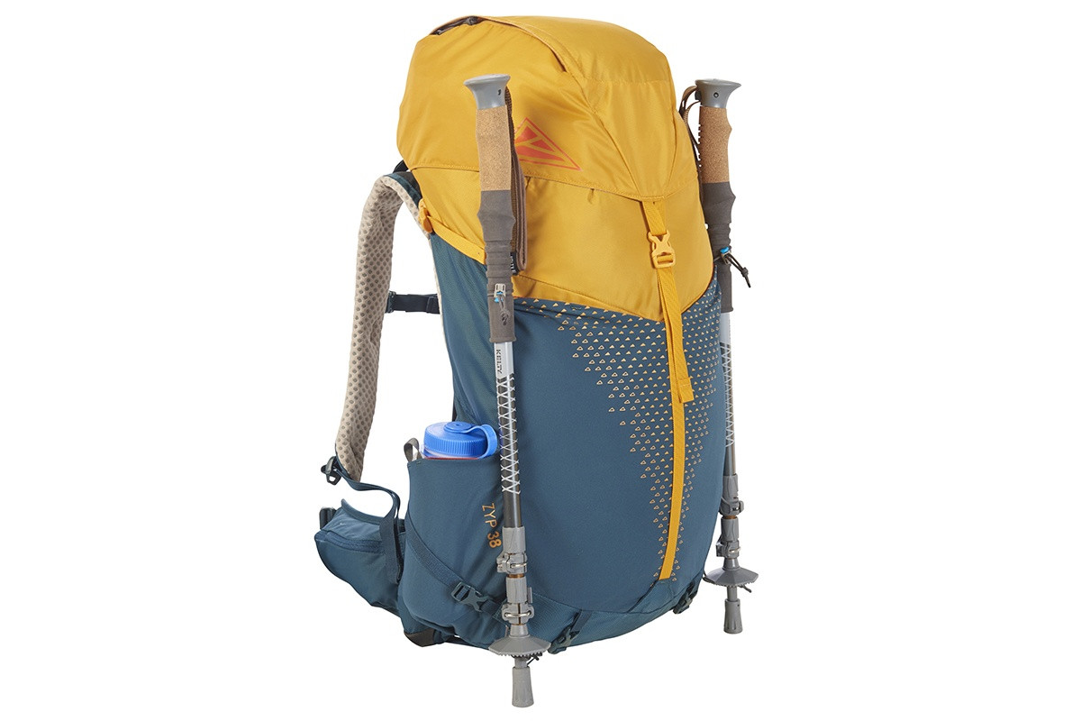 Kelty Zyp 38 backpack, Sunflower, with trekking poles attached to sides of pack